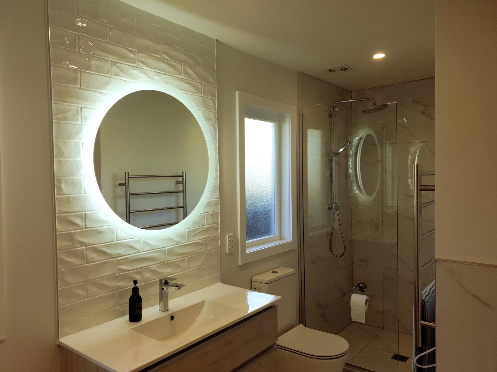 bathroom with round mirror